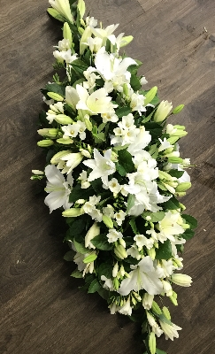 Lily and white Freesia casket spray
