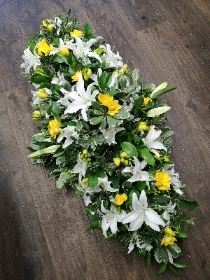 Lily and yellow Freesia Casket Spray